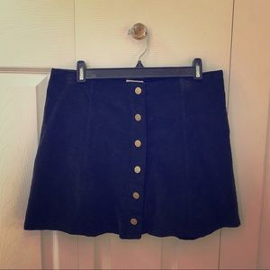 Mini corduroy skirt with snap front